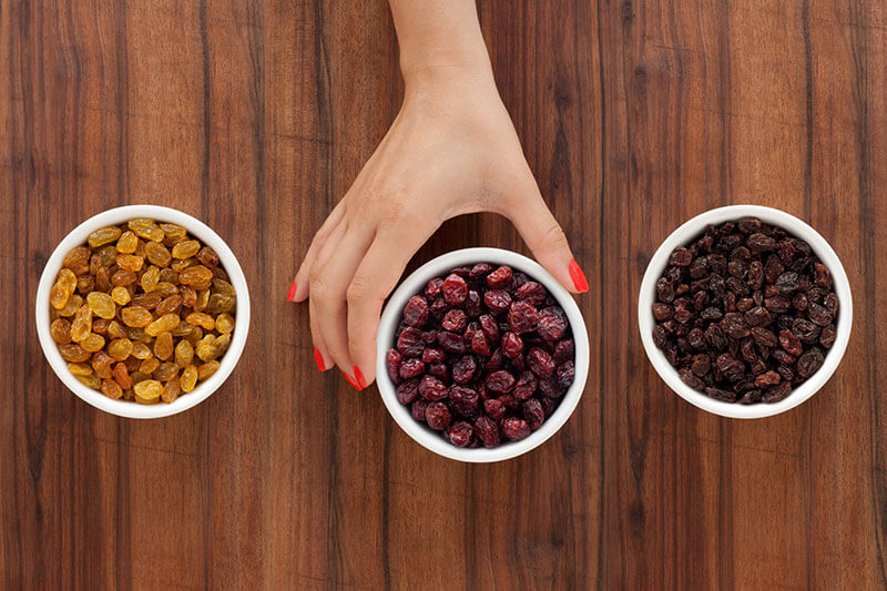 Golden Raisins, Dried Cranberries and Sun-Dried Raisins divided into small cups